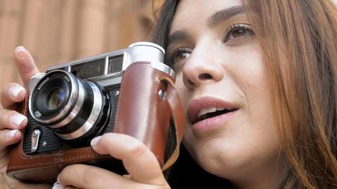 Portrait of happy smiling brunette girl making photographs with vintage film Footage