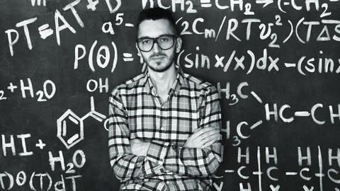 Young scientist man in laboratory with chemical and mathematical equations wall Photo