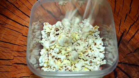 Fresh Popcorn Pouring in a plastic box Footage