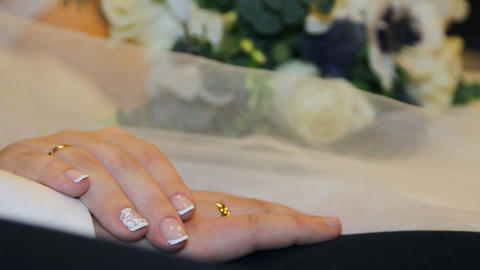 hands of bride and groom and wedding rings Footage