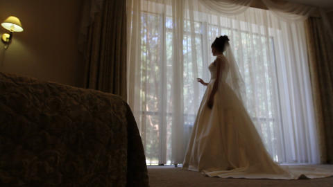 Bride looks out of the window ビデオ