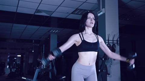 sports girl does exercises with dumbbells Footage