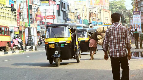 Indian Street with Rickshaws and People on Sunny Day Footage