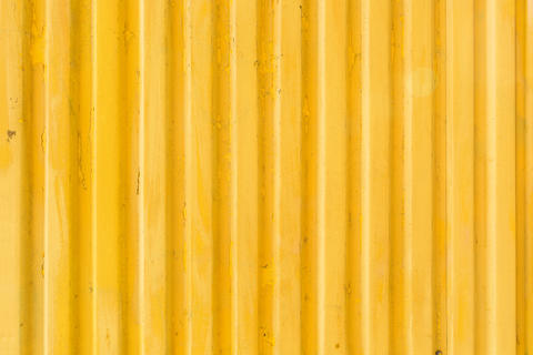 Yellow metallic background for pattern design artwork. Simply background Photo