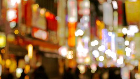 People moving at evening city street. Japan, Tokyo, Shinjuku district ビデオ