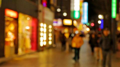 People walking at street with illuminated shopping malls ライブ動画