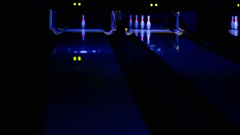 Bowling ball rolls along the path in the direction of one pin. The second throw Live Action