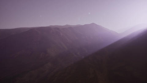 4K .Aerial. Flight in mountains like bird through fog Footage