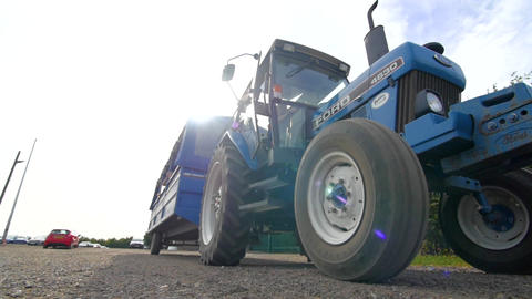Blue tractor moving forwards Live Action