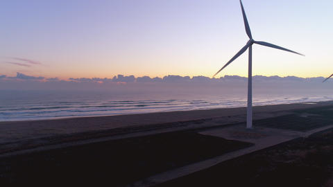 Aerial - Pacific Ocean and wind farm at dawn Footage