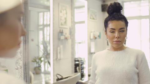 Beautiful woman enjoys her skin looking in the mirror Footage