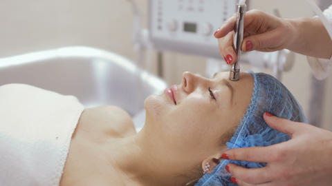 Procedure of rejuvenation facial skin with professional apparatus Footage