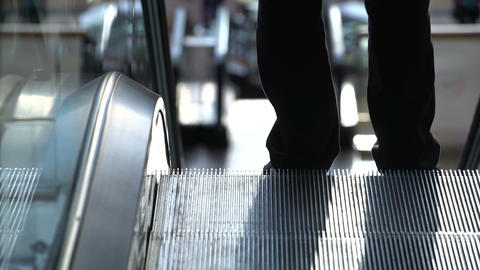 Man descends shopping mall escalator 영상물