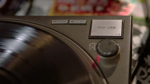 Close up of a record player being switched off Live Action