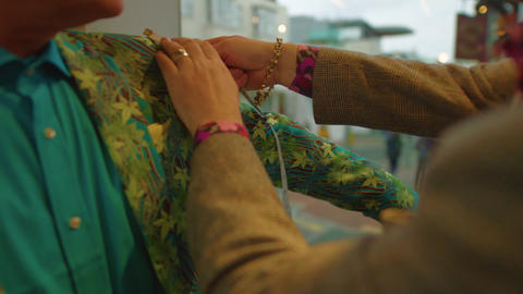 Man on colourful suit gets arm measured at the tailors Stock Video Footage