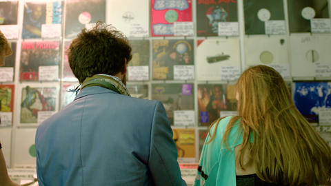 Panning shot of trendy youths record shopping Live Action