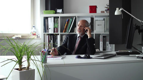 Business man talking over the phone in his office Footage