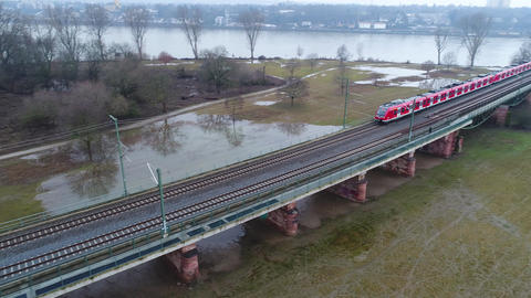 Red German S-Bahn train driving on a railway bridge Footage