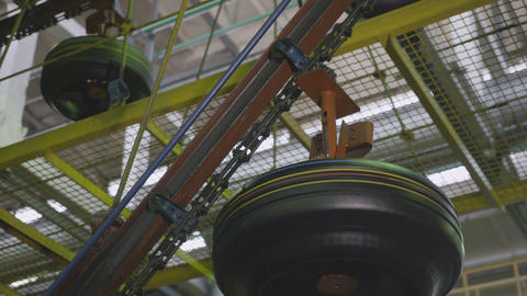 Air Conveyor Transfers Tire to Operation at Work Shop Closeup Live Action