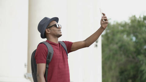 African american tourist man having online video chat using his smartphone Footage