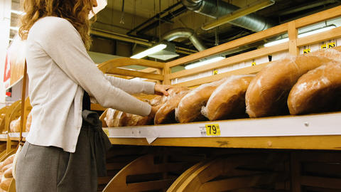 Girl chooses fresh bread in the shop, 4k Live Action