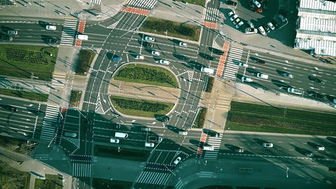 Aerial top down view time lapse of road traffic on big intersection Footage