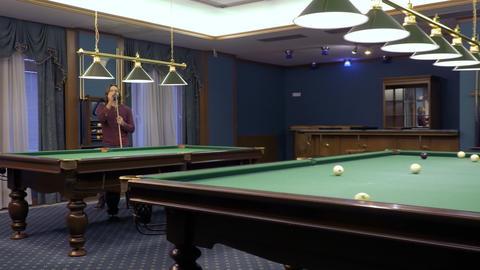 Man rubs billiard cue with a chalk Footage