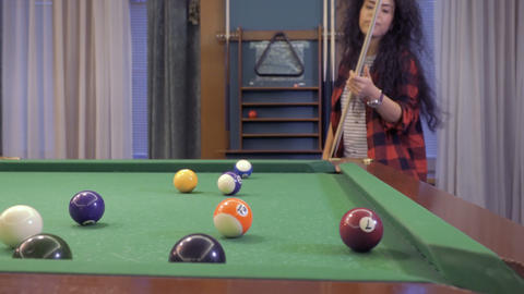 Pretty brunette learns to play billiard Footage
