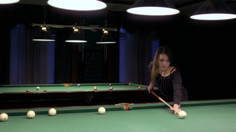 Young pretty brunette plays billiard Footage