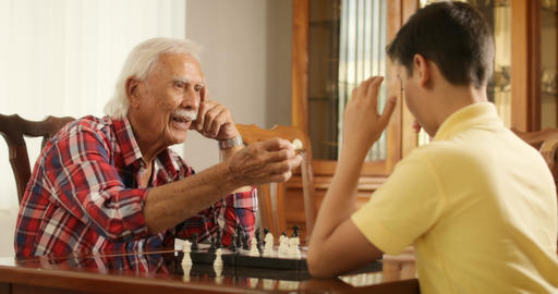 Grandpa Playing Chess Board Game With Grandson At Home Footage