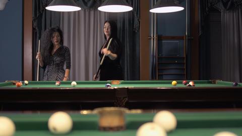 Beautiful sexy brunettes play billiard Footage