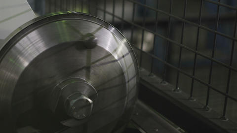 Roller Mechanism Rotates near Net Fence in Plant Closeup Footage