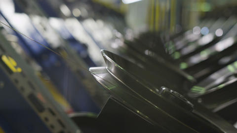 Side View Thin Metal Threads Reeled on Bobbins Macro Footage