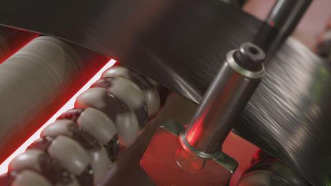 Tyre Strip Moved by Conveyor between Metal Pins Macro Footage
