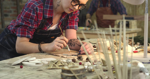 Young Hipster Painting Handmade Goods in her Studio Footage
