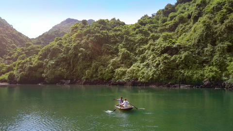 Couple Sails on Boat on Lake by UNESCO Heritage Bay Live Action