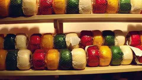 A lot of colorful cheese on factory shelf in the Netherlands Fotografía