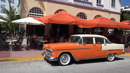USA Florida Miami Beach old orange american car decorates Ocean Dr edge line 영상물