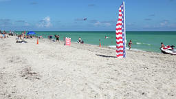 USA Florida Miami South Beach stars and stripes flag is waving in wind Footage