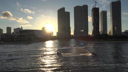 USA Florida Port of Miami Park West skyscrapers and jet skis against setting sun Bild