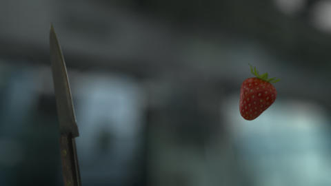 Knife Slicing Strawberry (With Background) Footage