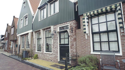Typical small Dutch houses facades in Volendam, Netherlands Live Action