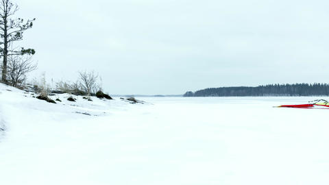 Time-lapse of ice sailing with a kitewing at a frozen lake Live Action