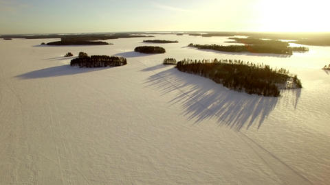 Islands with long shadows at a frozen lake Footage