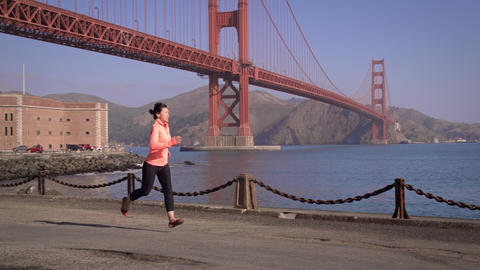 Woman Jogging Golden Gate Image