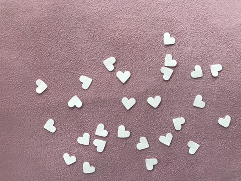 "heart shape white papers on light pink plain fabric, ""valentine's day"" concept Fotografía"