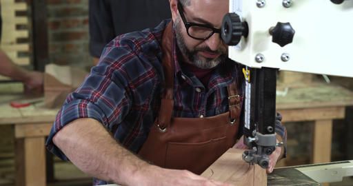Mature Cabinet Maker Creates a Cabrioli Leg Using Bandsaw Footage