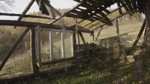 Wooden house deserted and almost completely destroyed by the winds of loneliness Live Action