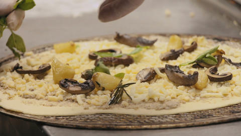 Chef preparing a Pizza Bianca with olive spread, cheese and pieces of garlic and Footage