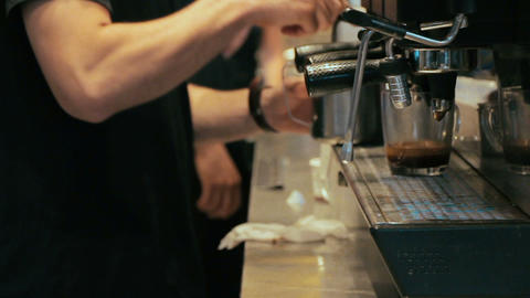 Barista making coffee in coffee machine at a busy coffee shop Footage